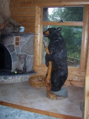 Bear Holding a Stump